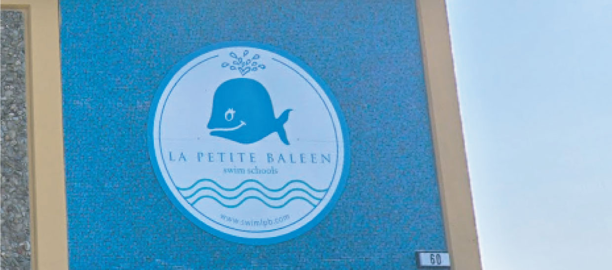 La Petite Baleen logo on building